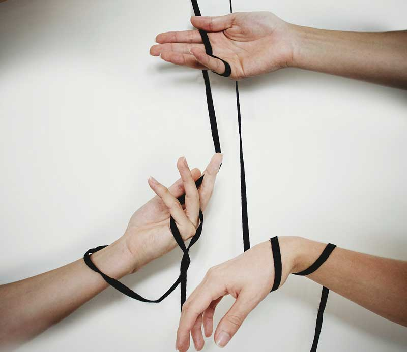 hands connected by different strings