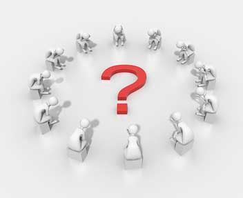 group of people sitting in a circle around a question mark