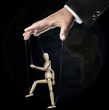 a puppet being controlled by a hand